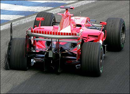 Schumacher's car crawls back to the pits with a puncture