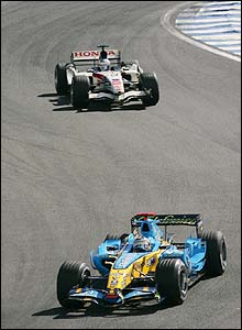 Alonso is trailed by Jenson Button