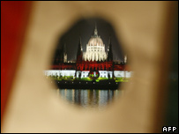 The Hungarian parliament, seen through the national flag