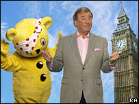 Mascot Pudsey Bear and Terry Wogan in front of Big Ben