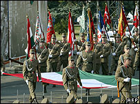 Hungarian soldiers carry the national flag in Budapest