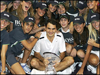 Roger Federer with Madrid ball girls