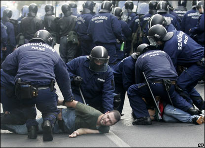 Riot policemen arrest protesters in Budapest, Hungary