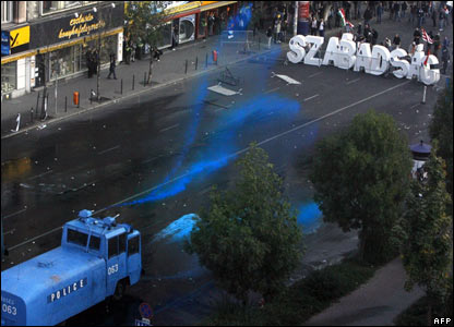 Hungarian police fire water cannon on a group of protesters in central Budapest, Hungary