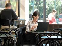 Woman using net in a cafe, BBC