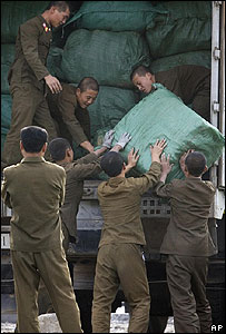 North Korean soldiers load up goods in the city of Sinjuiju opposite the Chinese border of Dandong on 21 October 2006