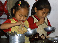 Children eating WFP-donated food in Hyangsan, North Korea, on 12 October 2006. Picture from WFP