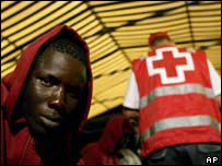 Immigrant in Red Cross tent