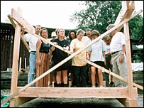 Castaway volunteers learning how to build a house