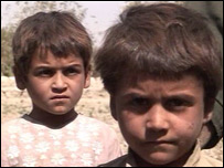 Afghani boys, orphaned by a bomb on their house
