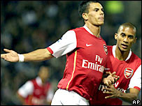 Jeremie Aliadiere celebrated his first goal with Arsenal team-mate Armand Traore