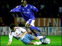 Aston Villa's Liam Ridgewell slides in on Elvis Hammond