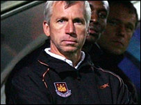 West Ham manager Alan Pardew watches his team at Chesterfield