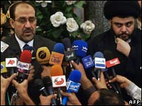 Nouri Maliki (left) seen with Moqtada Sadr in Najaf on 18 October