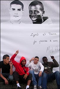 Clichy youths pointing to the picture of the two teenagers killed in 2005