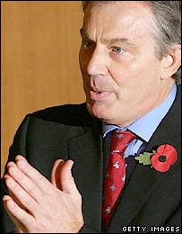 Tony Blair wearing his poppy