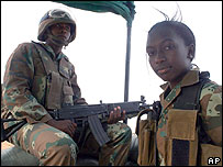 Peacekeepers on guard at the Kutum base of South African peacekeepers in northern Darfur 