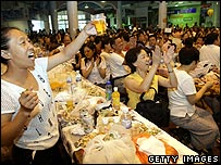 People celebrate at the Qingdao beer festival in China