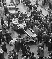 Civilians crowd around a tank in the anti-Communist uprising
