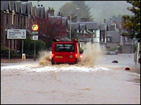 A van splashes down a road in Dingwall
