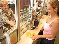 A woman buying Premium Bonds