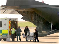 Baby being loaded into an RAF Hercules aircraft