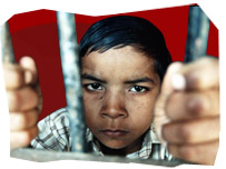 A picture of a child behind bars