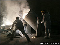 Men at work inside Iran's plant at Isfahan to make hexaflouride (uranium) gas