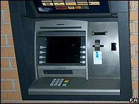 A machine with a card skimmer fitted, covering the whole right hand side of the cashpoint