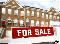 Cartel de vivienda a la venta