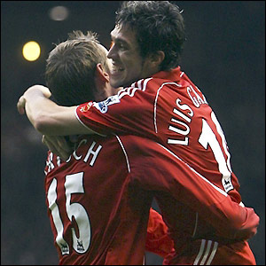 Crouch and Garcia celebrate Liverpool's second goal