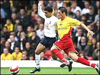 Aaron Lennon in action against Tommy Smith at Vicarage Road
