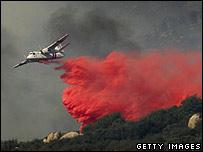 An air tanker drops fire retardant near Banning, California