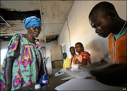 An election worker processes voters at a polling station in Bumba in DR Congo's Equatorial province.
