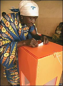 A woman casts her vote for president at a polling station in Goma, Congo.