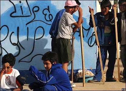 Children outside the Emiliano Zapata school closed by striking teachers in Oaxaca