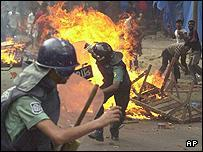 Riot police officers attempt to control a demonstration in Dhaka