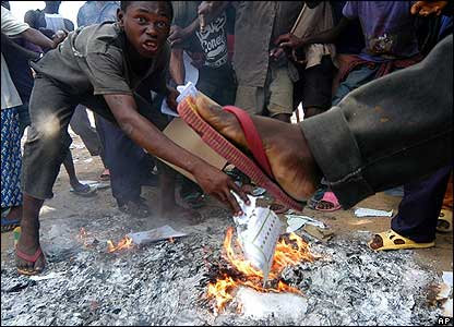 Protesters burn ballot papers in the north-eastern town of Bumba