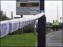 Police seal off the scene near where the body was found