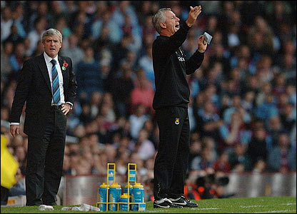 Managers Mark Hughes and Alan Pardew patrol the touchline