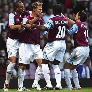 Teddy Sheringham is congratulated by team-mates