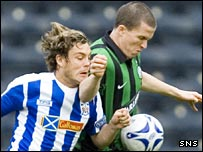 Gary Caldwell holds off David Fernandez at Rugby Park