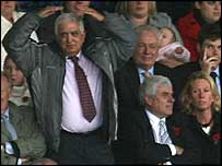 Sam Hammam does the 'Ayatollah' for Cardiff fans at the Derby game