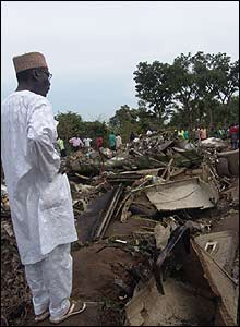 Nigerian Senator Umaru Dahiru inspects the crash in which three of his children died