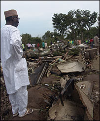 Senator Umaru Dahiru whose three children were victims watching the relics the site of an ADC aircraft that crashed shortly after take-off at the Nnamdi Azikiwe Airport, Abuja [Pic: Abayomi Adeshida]