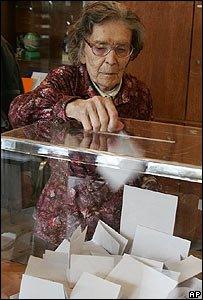 An elderly woman casts her ballot in Belgrade on 29 October