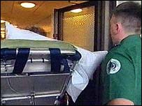 patient being wheeled in to hospital
