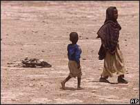 Children walk past animal carcass in Ethiopia