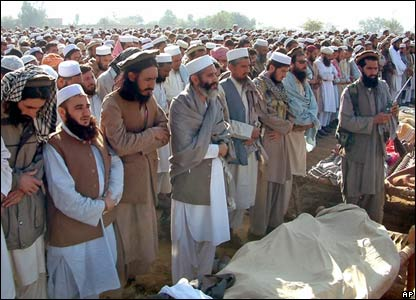 Men look at the dead bodies of alleged militants killed in the Pakistani military air strike in Bajaur, on the border with Afghanistan.