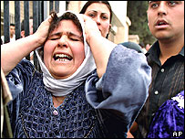 An Iraqi woman screams outside a hospital